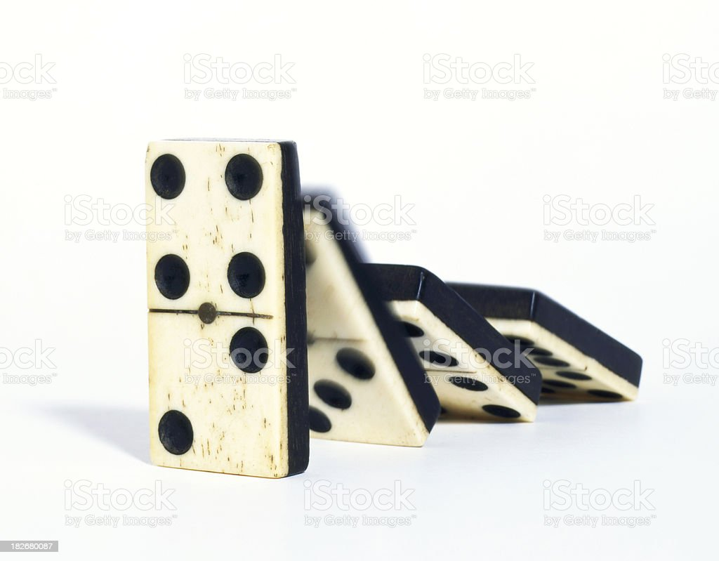 Antique toppling dominoes royalty-free stock photo