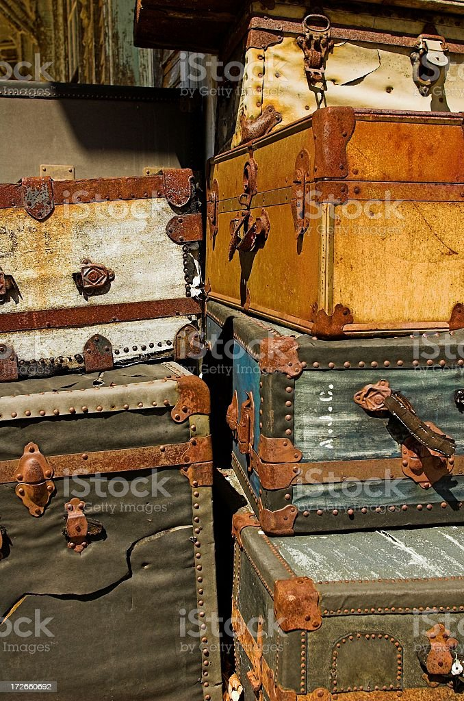 Antique trunks and suitcases stacked vertically royalty-free stock photo