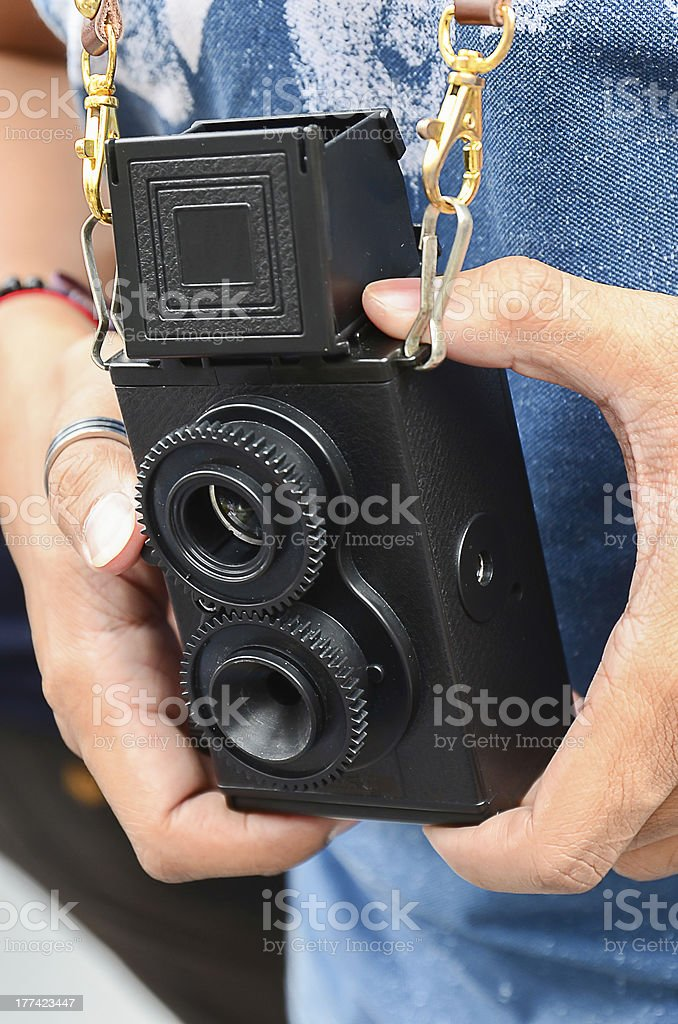 Antique Twin Lens Reflex Camera on hands stock photo