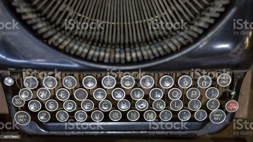 Antique typewriter focus on letter keys stock photo