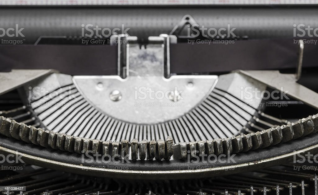 antique typewriter typebars with focus on the at symbol stock photo