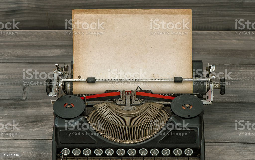 Antique typewriter with grungy paper page stock photo