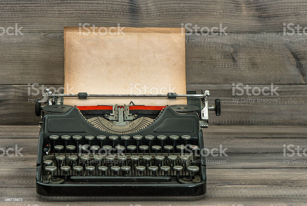 antique typewriter with grungy textured paper page stock photo