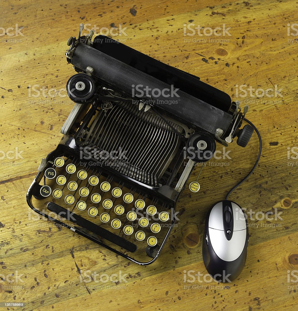 Antique typewriter with mouse stock photo