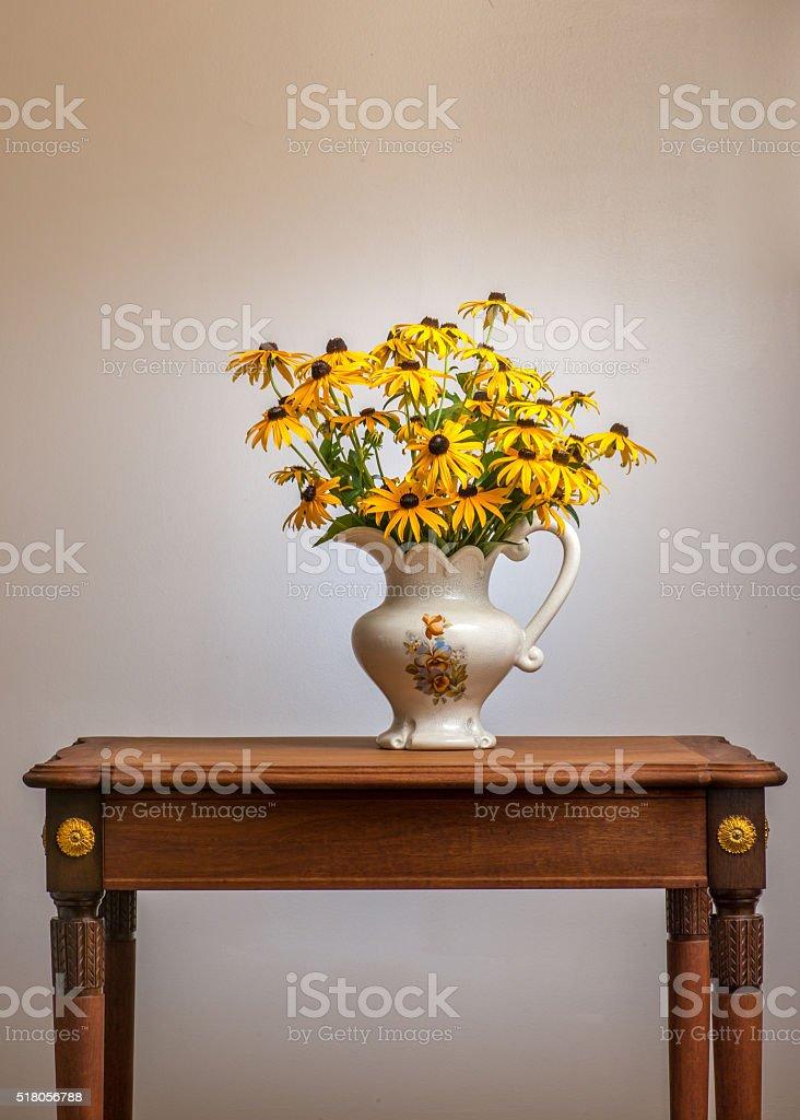 Antique vase on mahogany table stock photo