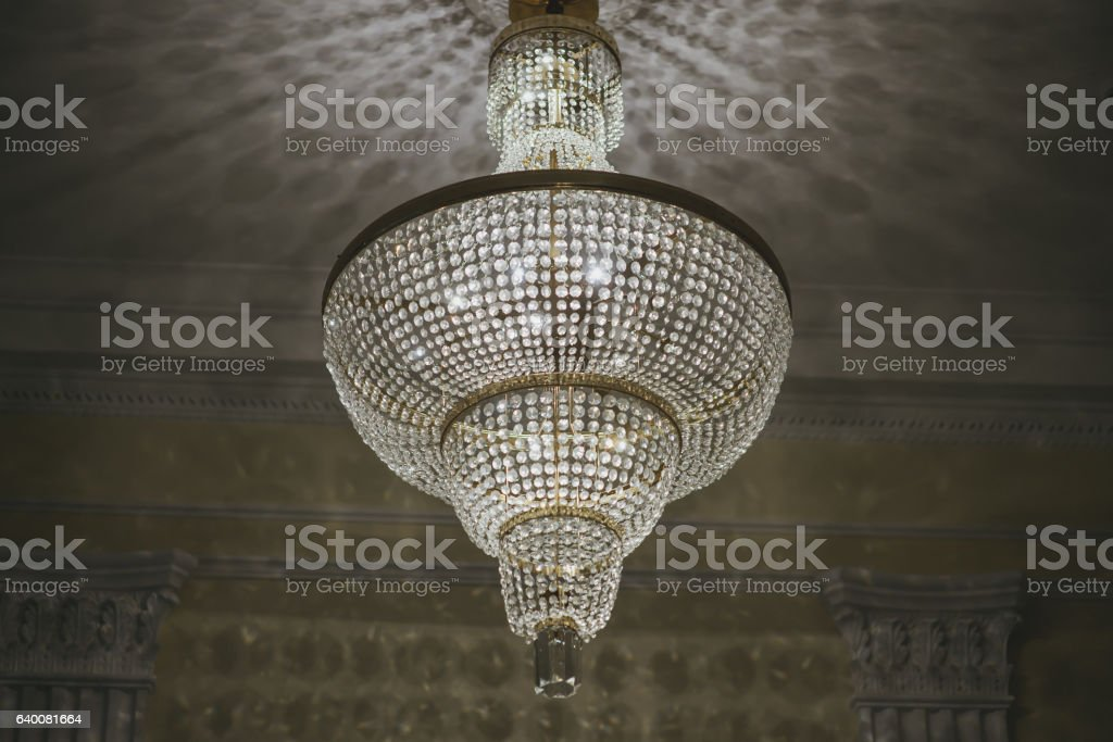 Antique vintage glass chandelier on the ceiling of the hall stock photo