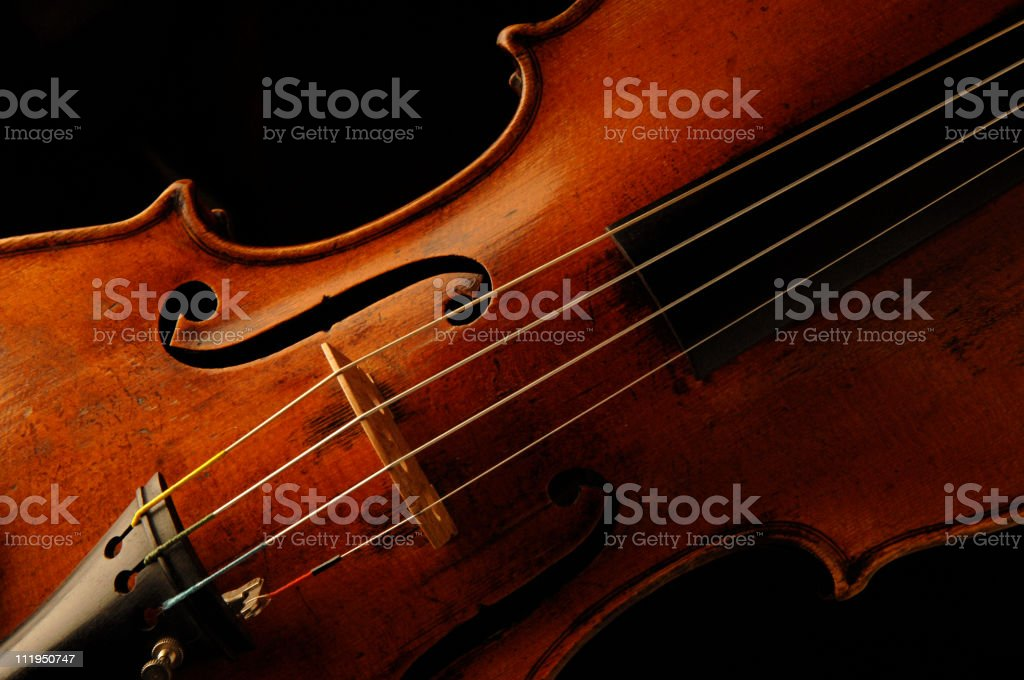 Antique Violin on black stock photo