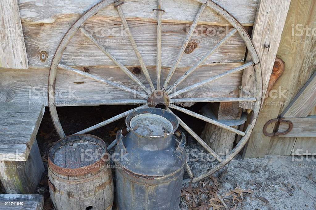 Antique Wagon Wheel and Water Barrels stock photo