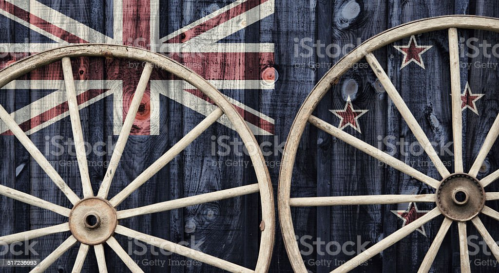 Antique Wagon Wheels with New Zealand flag stock photo