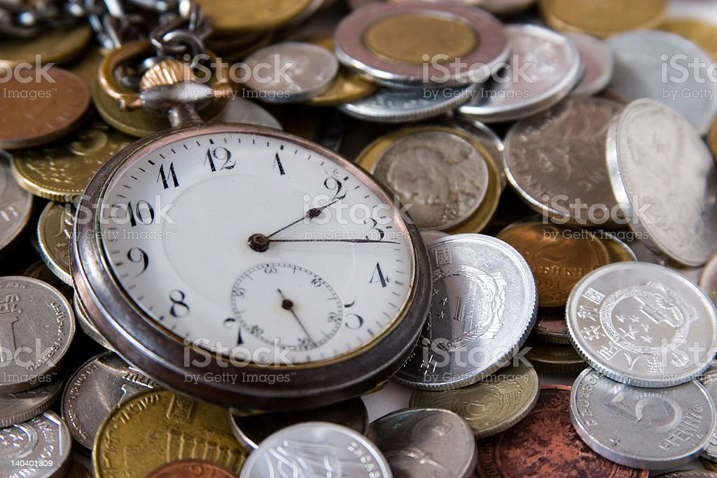 antique watch and coins royalty-free stock photo