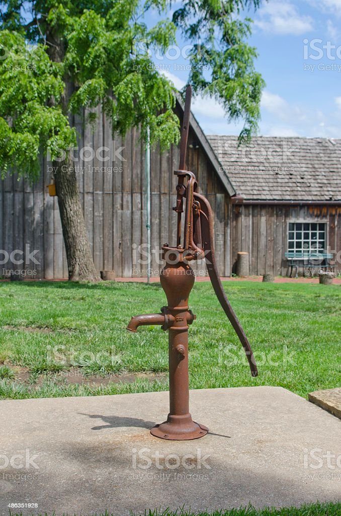 Antique Water Hand Pump stock photo