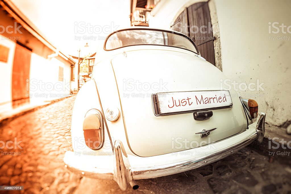 Antique wedding car with just married sign stock photo
