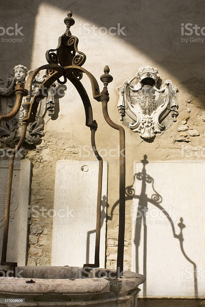 Antique well with wrought iron canopy stock photo