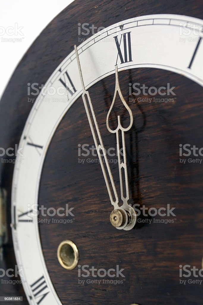 Antique Westminster chiming clock - 11:55 face View stock photo