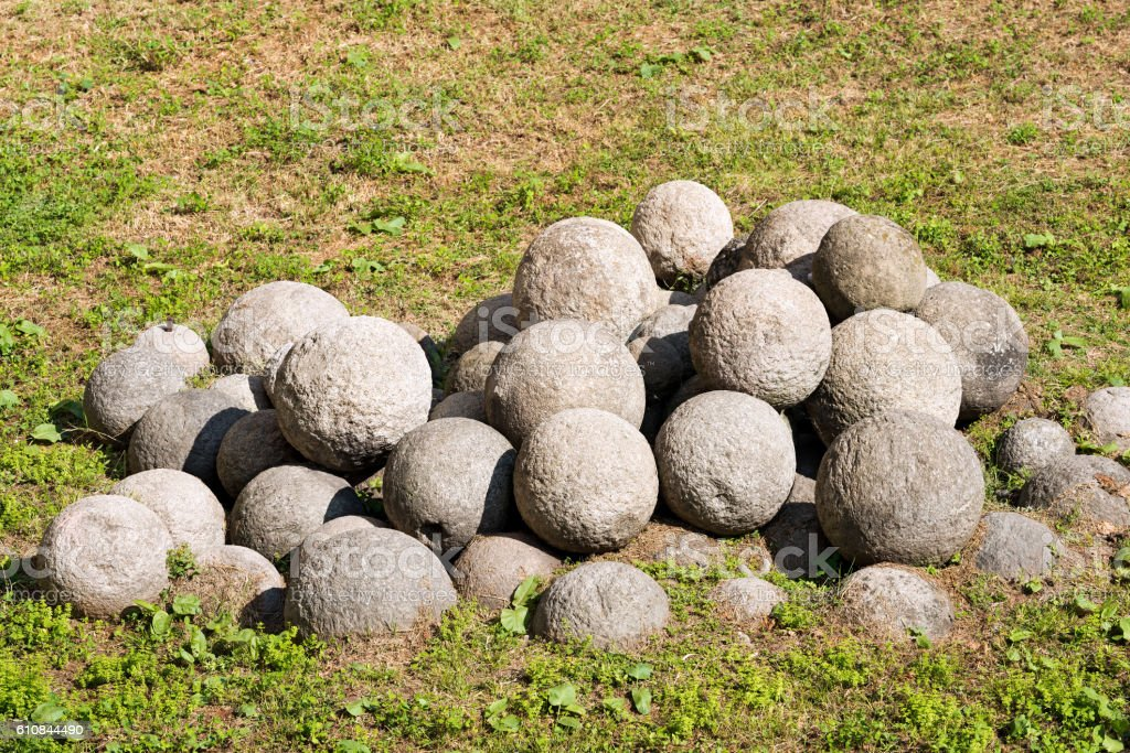 Antique White Stone Cannonballs stock photo