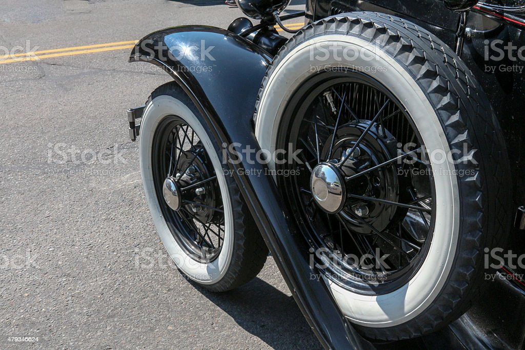 Antique whitewall car tire and spare stock photo