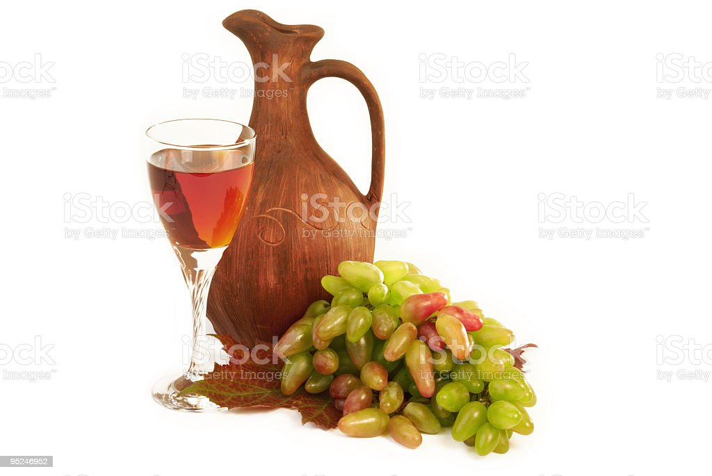 Antique wine jug, grapes and a glass stock photo