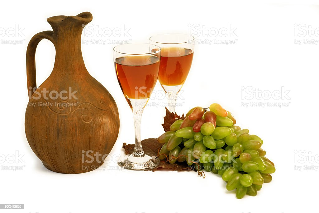 Antique wine jug, grapes and a glass royalty-free stock photo