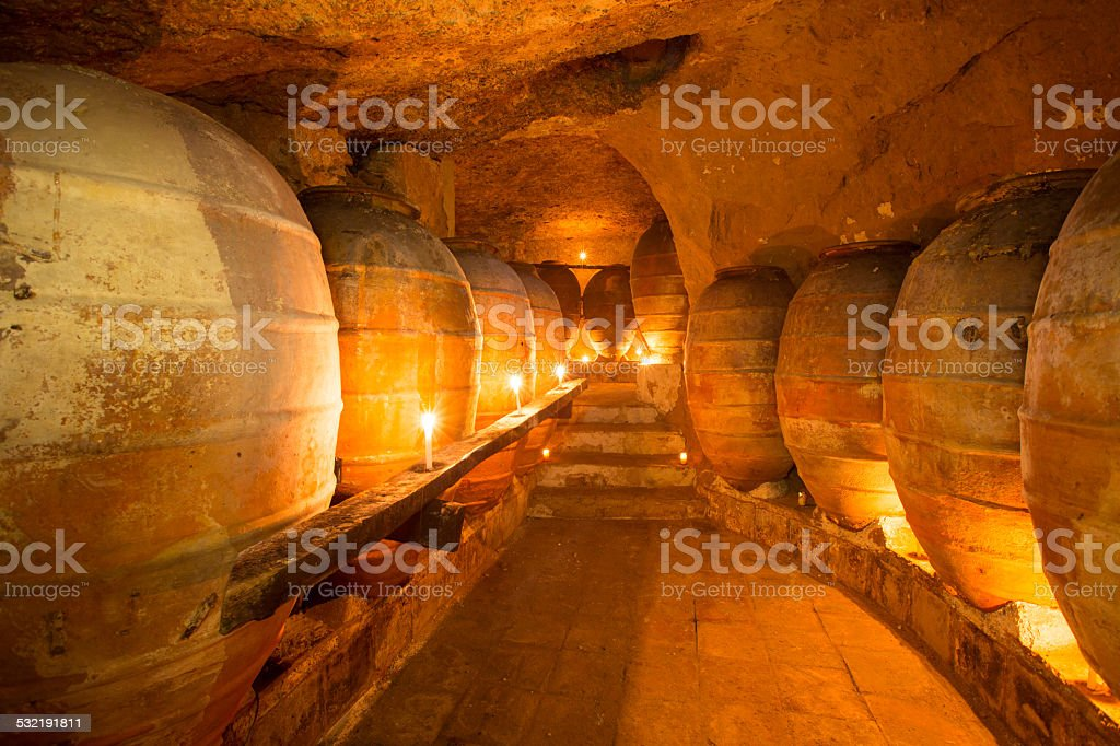 Antique winery in Spain with clay amphora pots stock photo