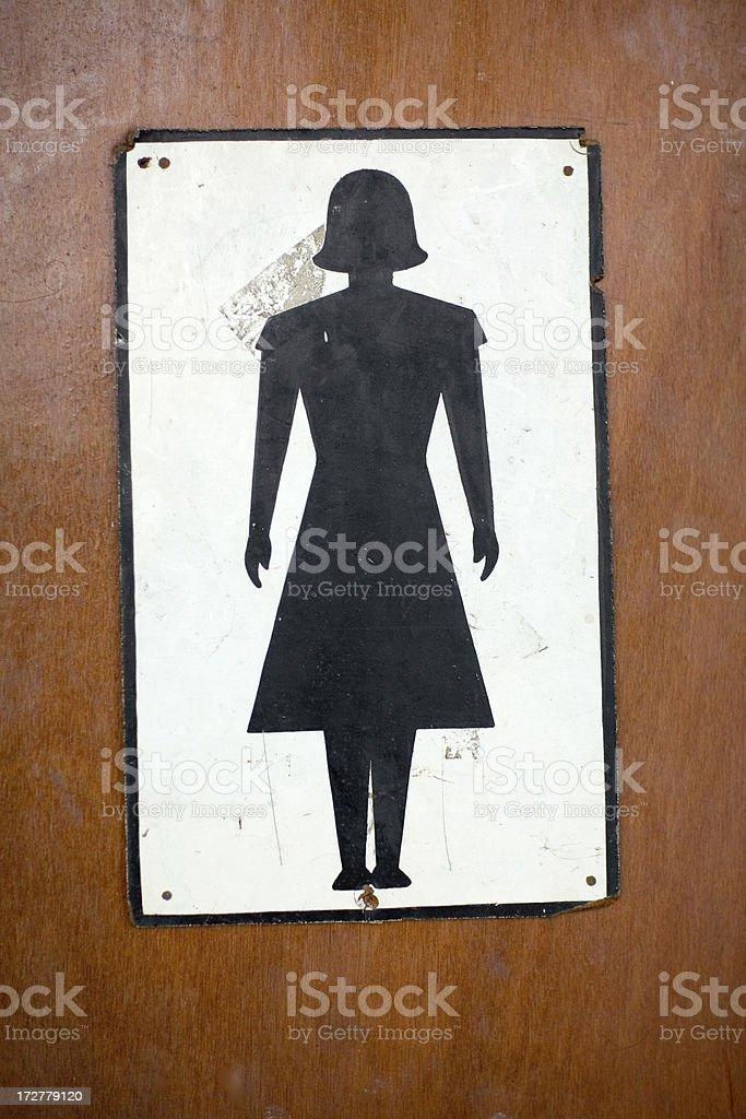 antique woman's toilet icon symbol on washroom door stock photo