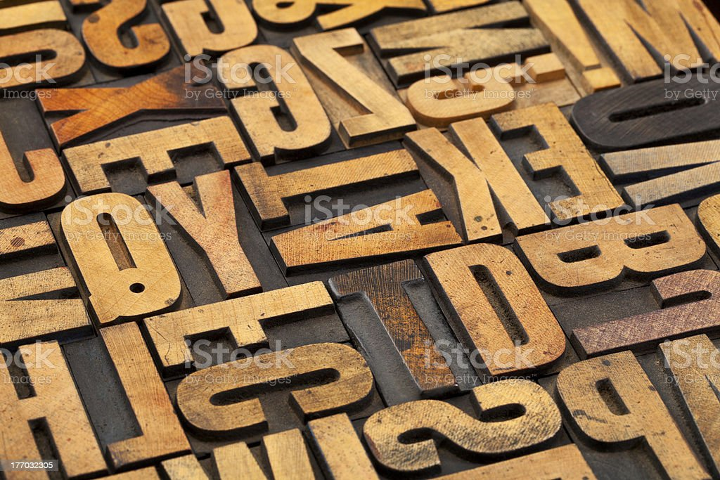 antique wood alphabet abstract stock photo