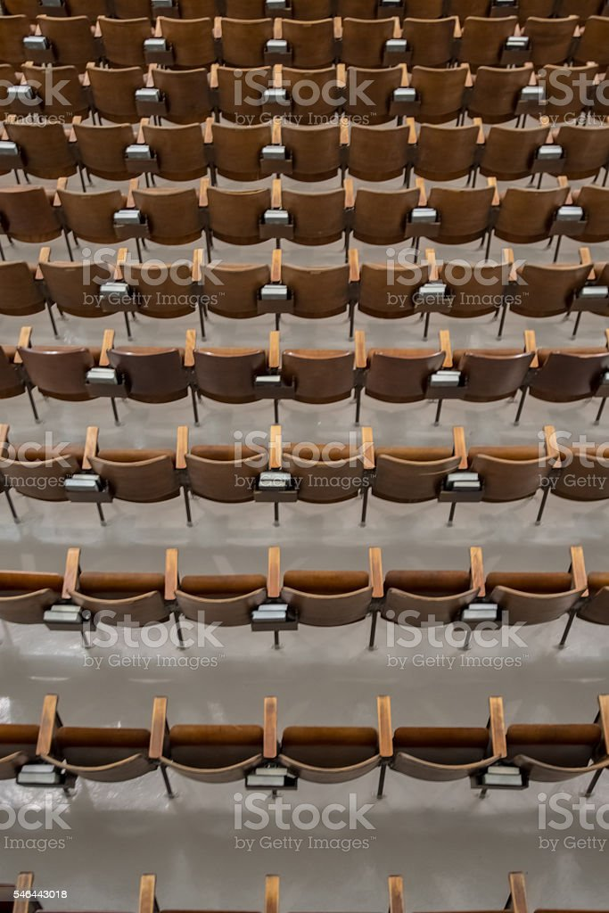 Antique Wood Auditorium Seats Above View From Behind stock photo
