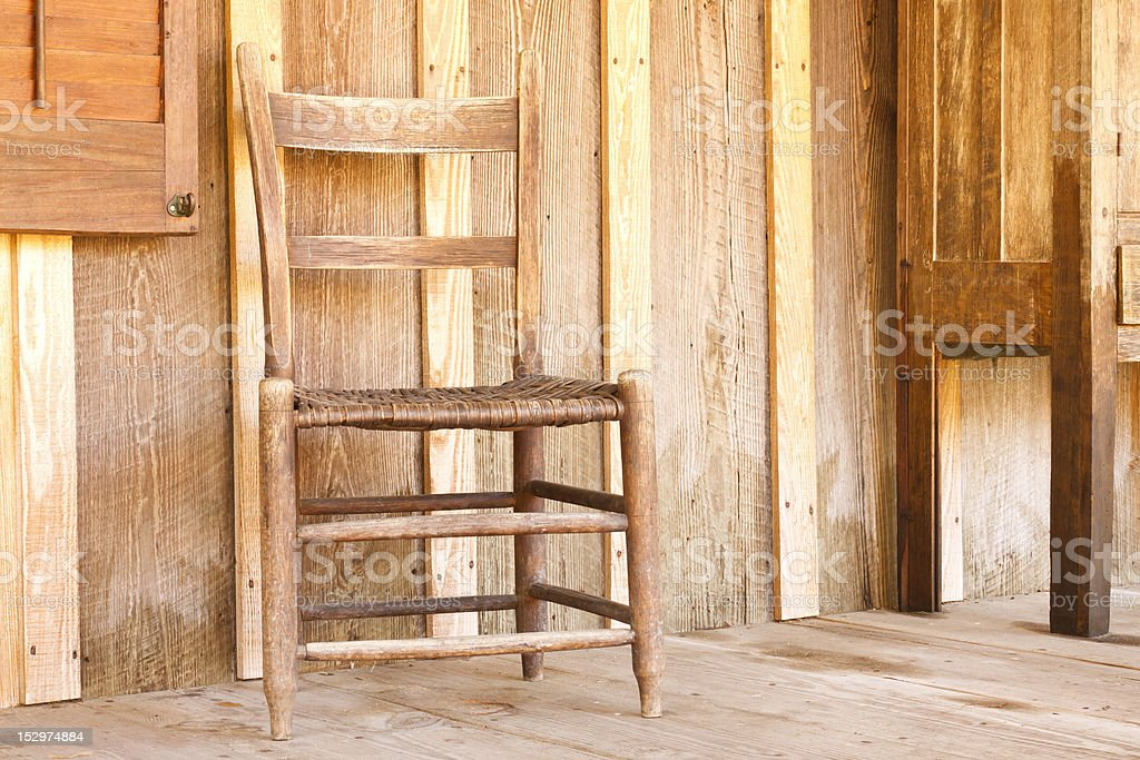 Antique Wood Chair On Farmhouse Porch stock photo