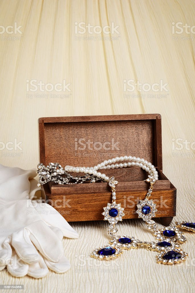 antique wood jewellery box and gloves stock photo