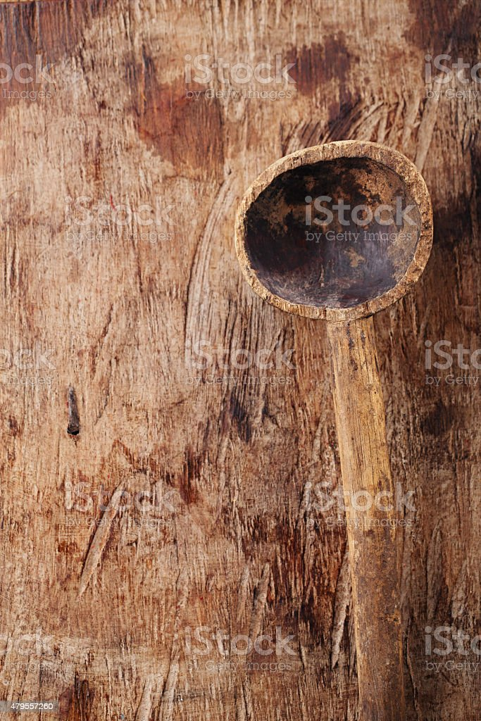 antique wood spoon on old wooden table in rustic style stock photo