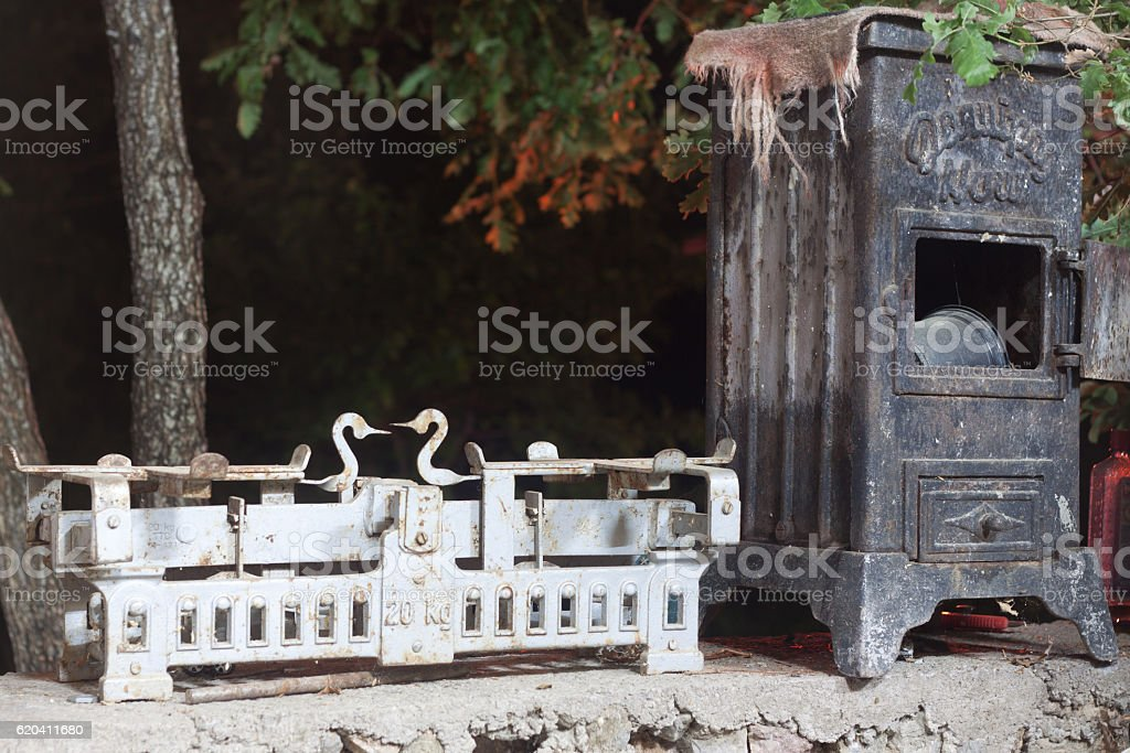 antique wood stove and Libra stock photo