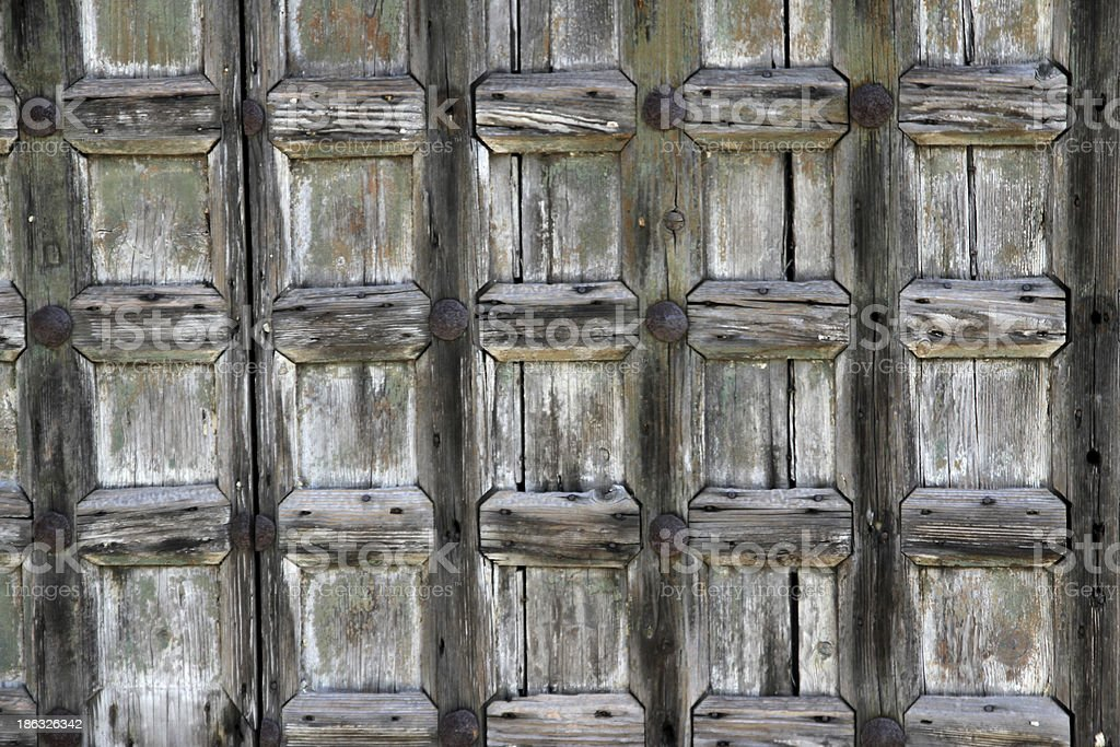antique wooden door with consume beams royalty-free stock photo