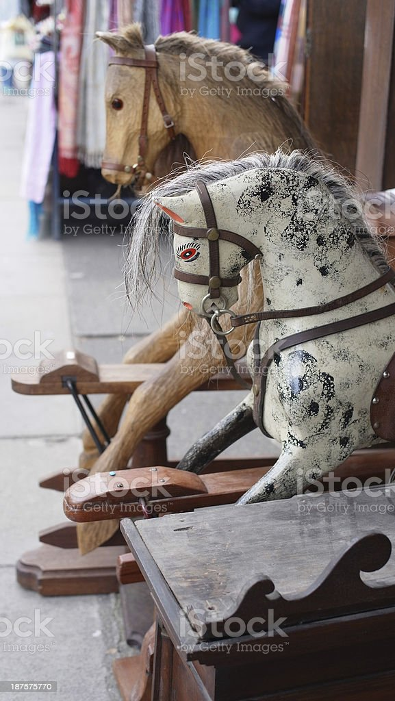 antique wooden horses at the street market royalty-free stock photo