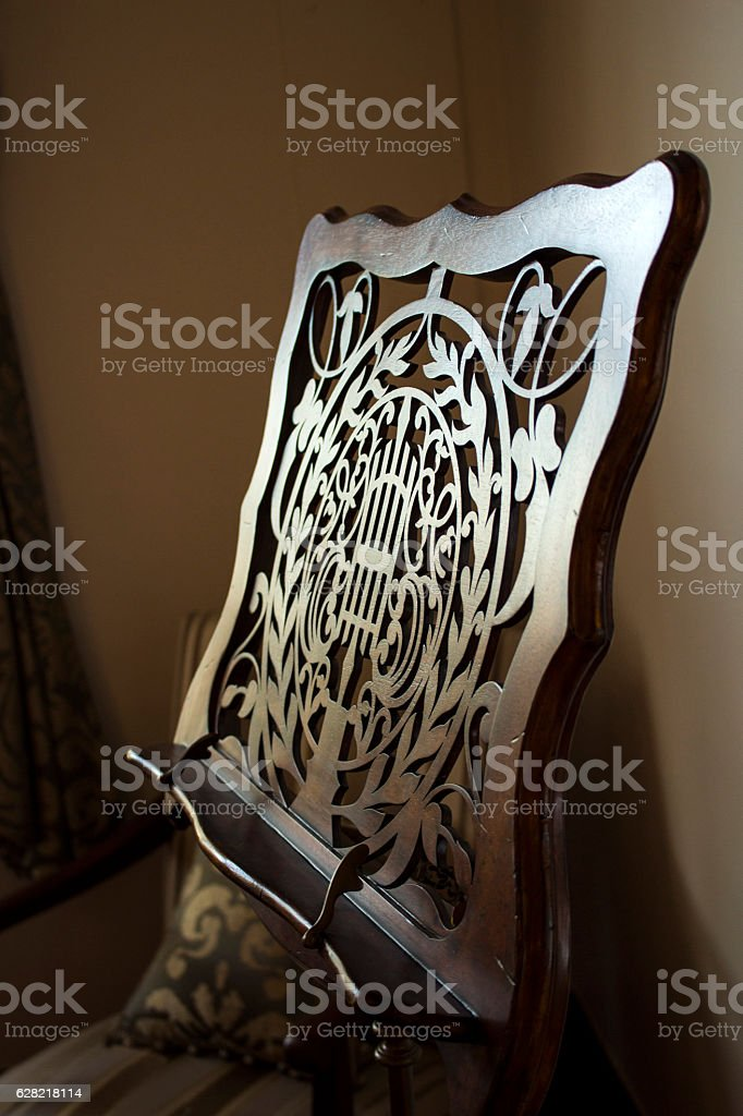 Antique wooden sheet music stand stock photo
