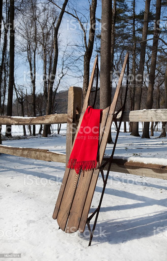 Antique Wooden Sled and Rail Fence royalty-free stock photo