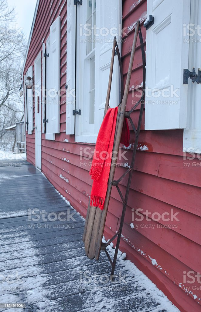 Antique Wooden Sled at an Historic Rail Station stock photo