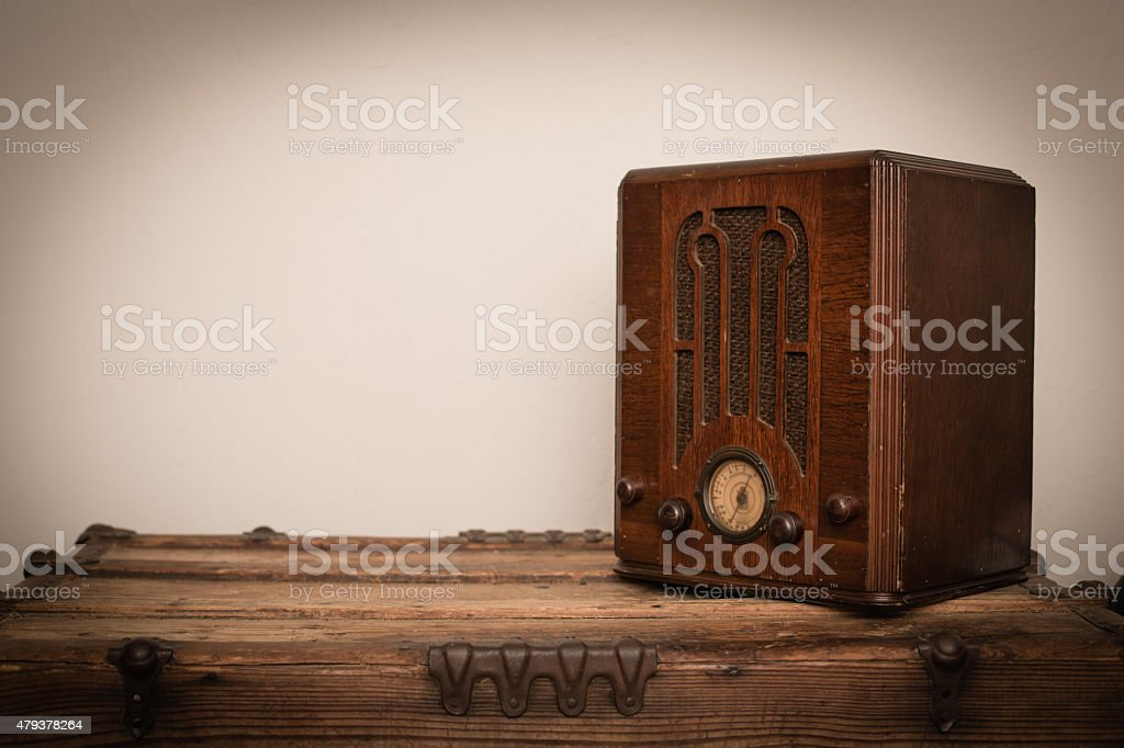 Antique Wooden Tombstone Radio from 1930s on Wood Trunk stock photo