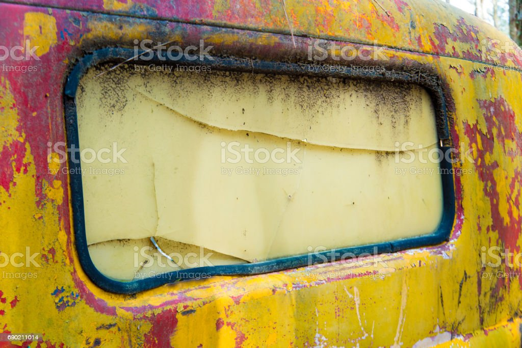 Antique yellow truck covered with pollen and moss. stock photo