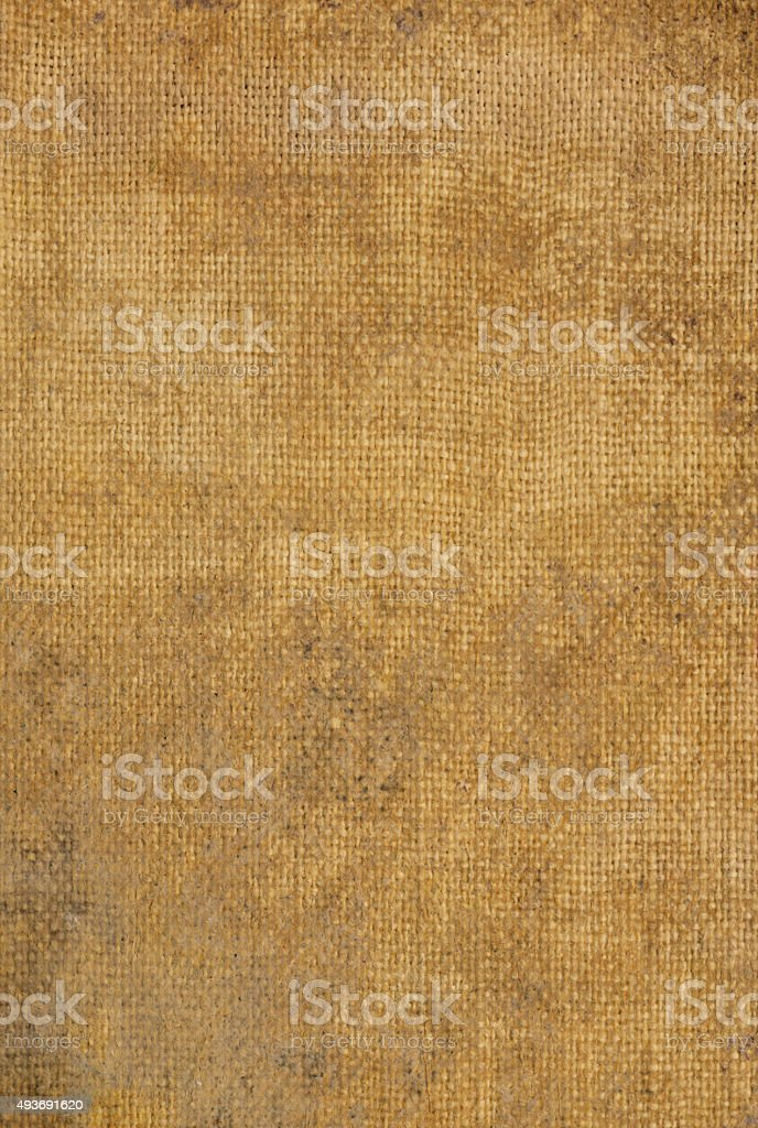 Antiqued brown canvas background with texture stock photo