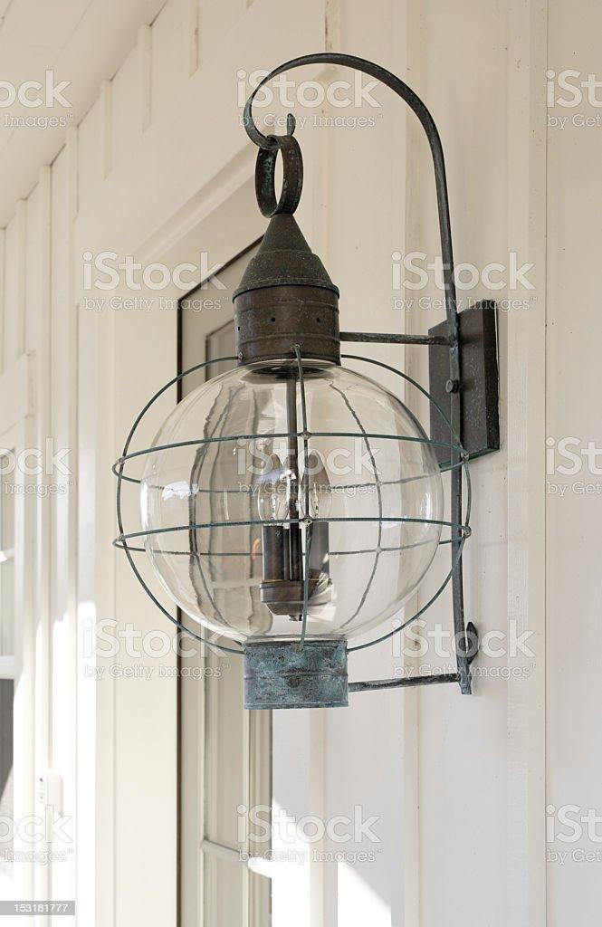 Antiqued Porch Lamp stock photo
