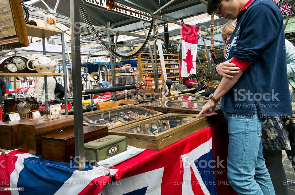 Antiques and bric-a-brac on a market stall stock photo