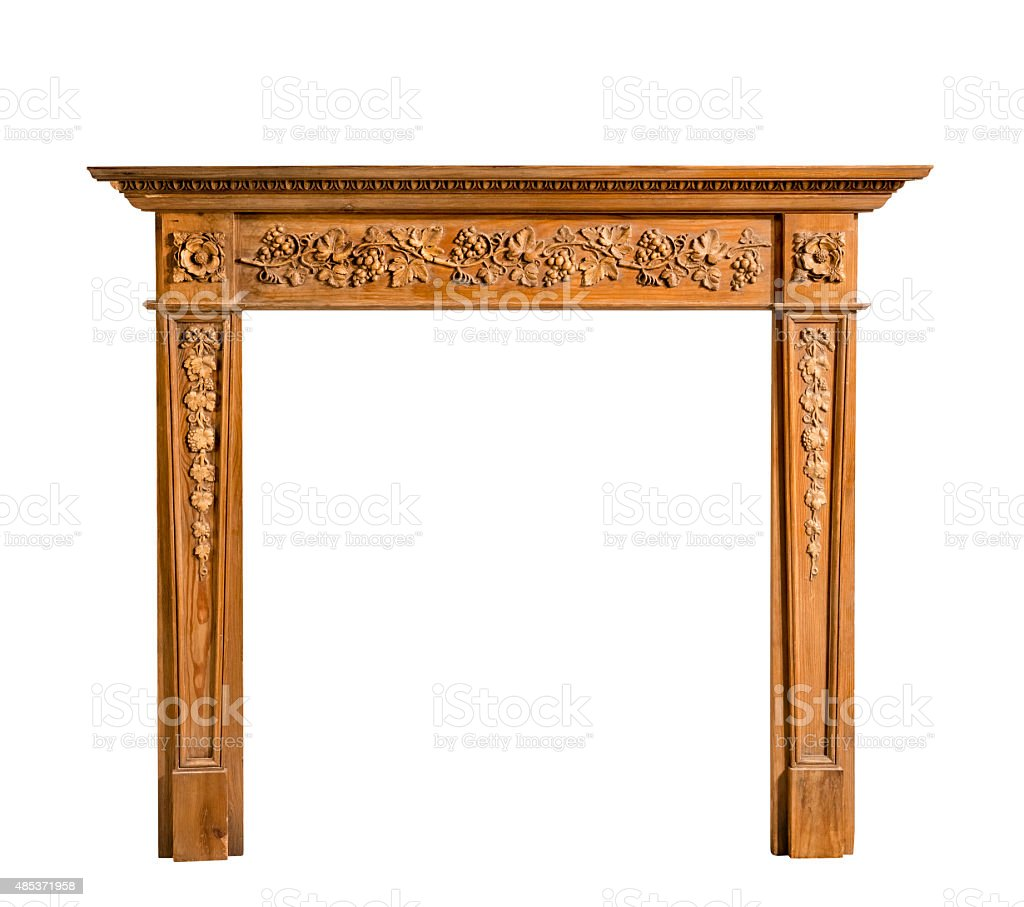 Antiqur pine fireplace surround with carving isolated on white t stock photo