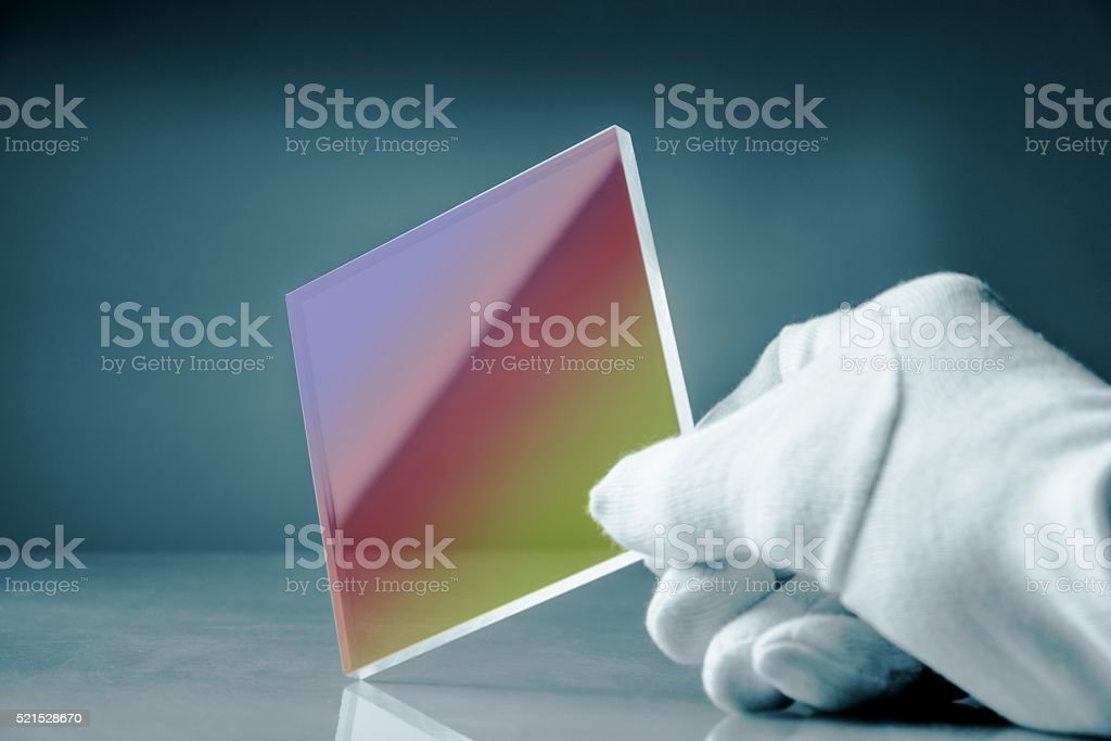 anti-reflective glass with an optical interference coating stock photo