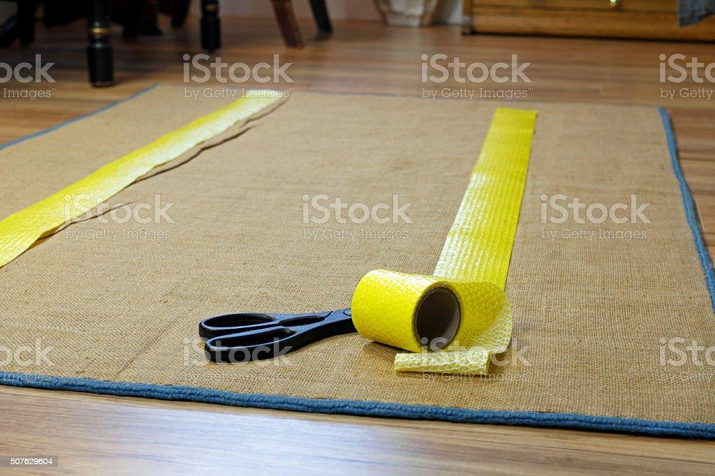 Anti-Slip Rug Tape and Scissors stock photo