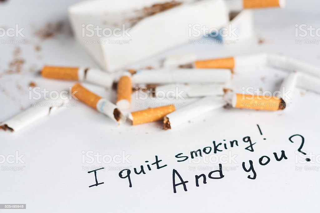 Antismoking background with broken cigarettes stock photo