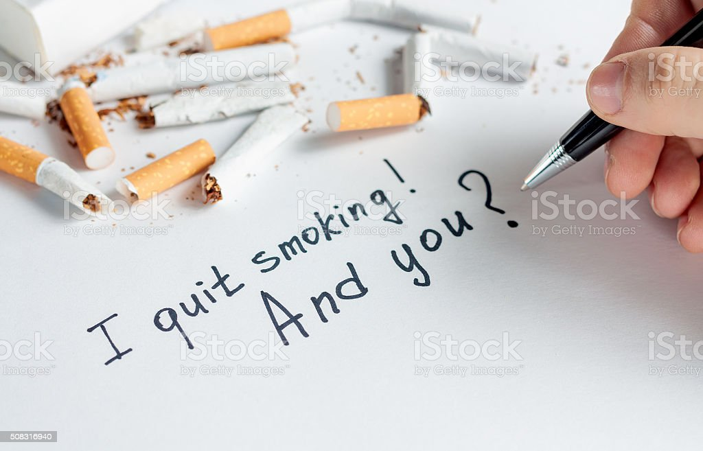 Antismoking background with broken cigarettes. Stop smoking stock photo