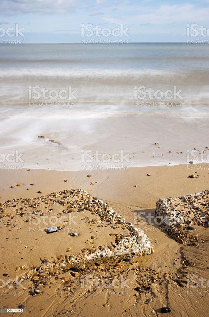 WWII anti-tank blocks in sand, Sizewell, Suffolk Coast, UK stock photo
