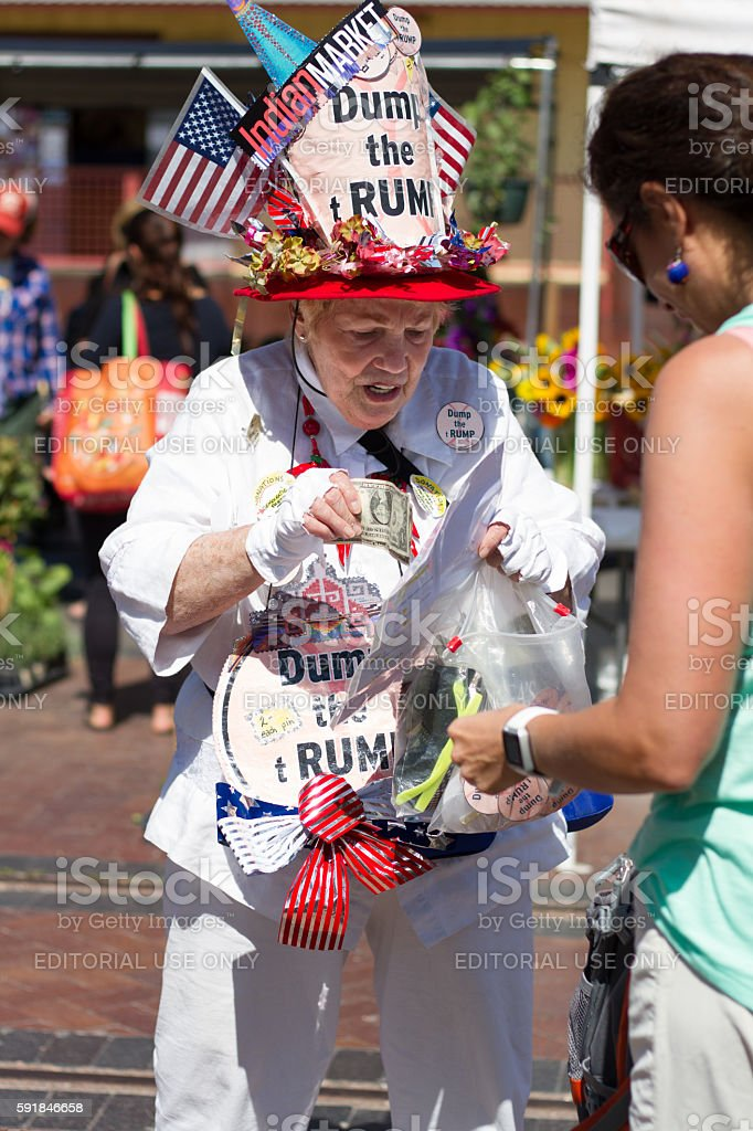 Anti-Trump Protester Sells 'Dump the tRump' Buttons stock photo