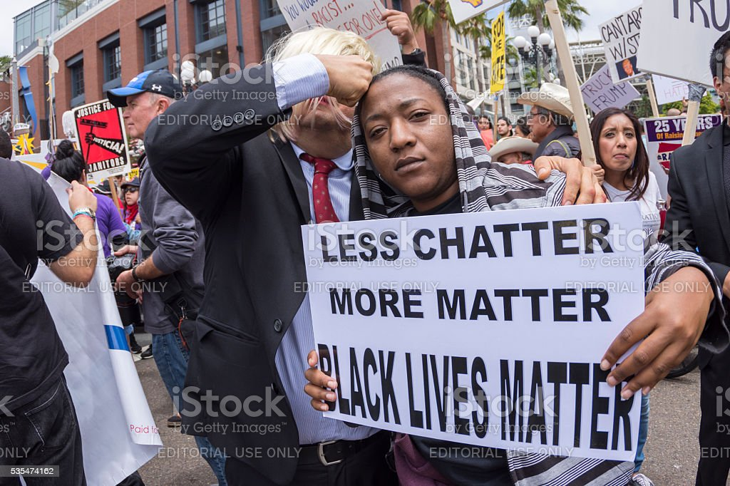 Anti-Trump protester with Black Lives Matter sign stock photo