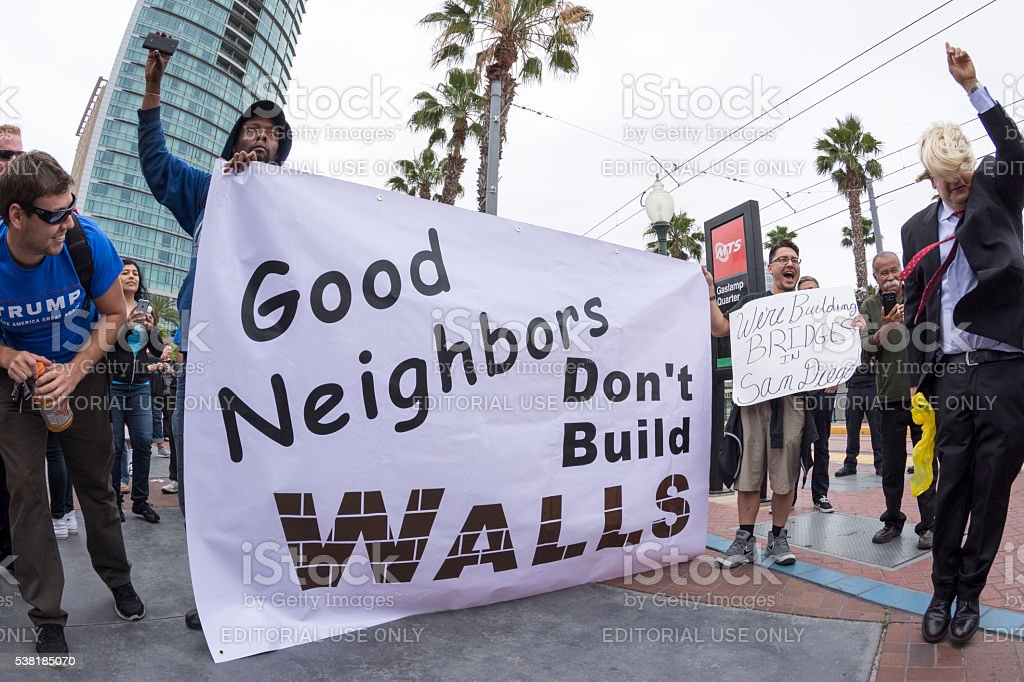 Anti-Trump protesters against the wall stock photo