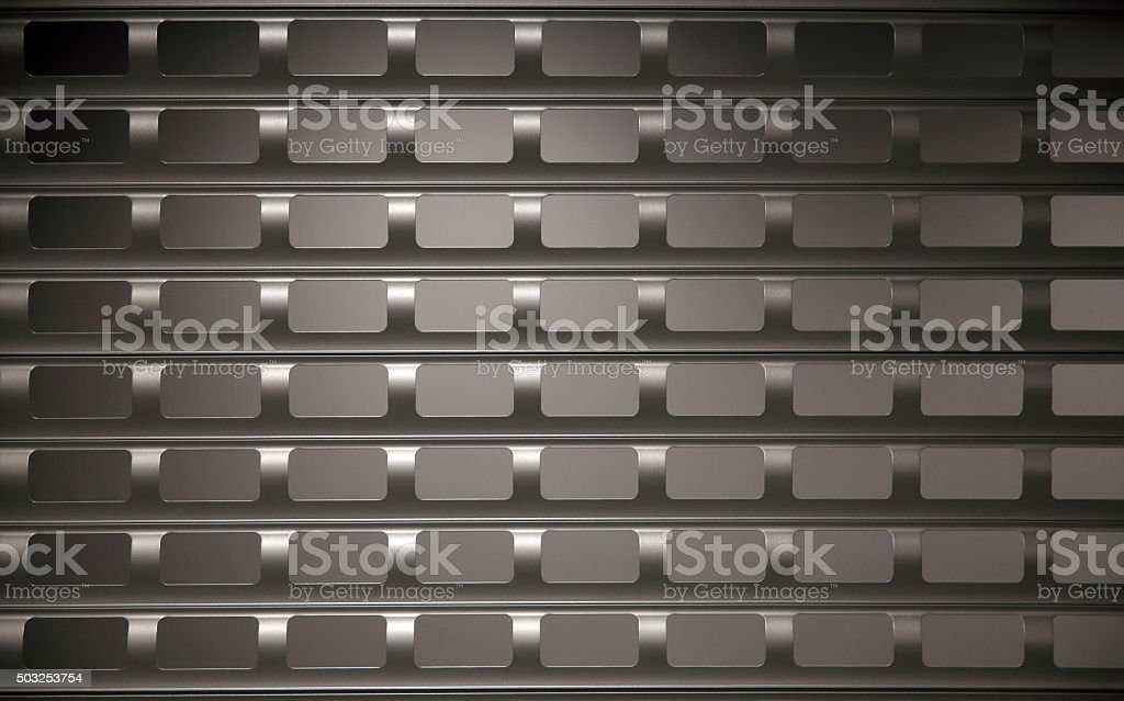 Anti-vandal / anti-theft rolling shutter protecting shop window and entrance door. stock photo